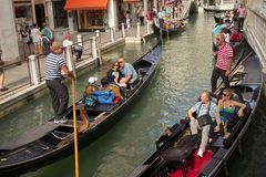 ITALY, VENICE - September 7: Gondolas with tourists cruising a s Stock Image