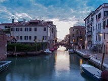 Italy, Venice - Smaller Canal with less traffic but is beautiful all the same. This small canal on what must be the outskirts of Venice is near devoid of people stock photo