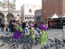 Italy. Venice. St Mark's Square (San Marco square) and girls Royalty Free Stock Photos