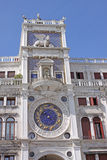 Italy. Venice. St Mark's tower with lion and clock royalty free stock image
