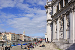 Italy. Venice. Tourists near The Cathedral of Santa Maria della Salute Stock Images