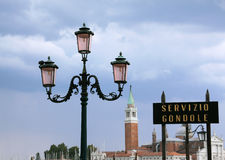 Italy Venice Traditional street Gondola station. Italy Venice Traditional Venetian street lamps and Gondola station on the lagoon in the wake of a thunderstorm royalty free stock photo