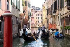 ITALY, VENICE, 18,09,2017, Two gondolas with people sail through royalty free stock images