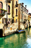 Italy. Venice. Water in small canal and architecture royalty free stock images