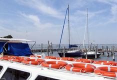 Italy, Venice, yacht port. Red safe guard rings in the yacht Stock Image
