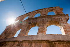 Italy, Verona, ancient amphitheater. Ancient wall and arch, bright rays of the sun? bright blue sky Royalty Free Stock Image