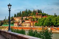 Italy Verona old italian house on knoll. Panorama with bank river Adige embankment street lamp Stock Image