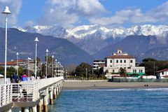 Italy Versilia, sea and mountains,. Massa, in Italy is nowadays a famous bathing resorts. From the beach it is possible to sea the Apuane mountains, covered by Stock Photography