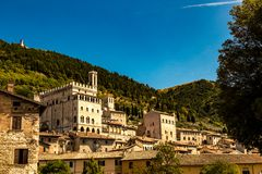 View of the ducal palace. Italy: view of the ducal palace of Gubbio. In the background the wooded forest of Mount Ingino Stock Photos