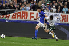 Italy vs Ireland soccer tackle Stock Photography
