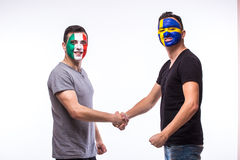 Italy vs Sweden handshake of equal game on white background. Stock Images