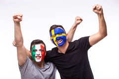 Italy vs Sweden on white background. Football fans of national teams celebrate, dance and scream. European football fans concept Stock Image