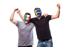 Italy vs Sweden on white background. Football fans of national teams celebrate, dance and scream. European football fans concept Stock Photos