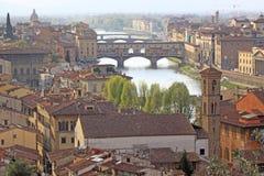 Italy. Vuew to Bridges in Florence. Ponte Vecchio. The Ponte Vecchio  Old Bridge  is a Medieval stone closed-spandrel segmental arch bridge over the Arno River Royalty Free Stock Photo