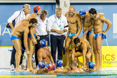Italy Water Polo Team. BARCELONA - JULY  30: Italian Coach Alessandro Campagna speaking  at the Team in Barcelona FINA Water Polo   Championships on July 30 Royalty Free Stock Image