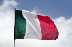 Italy waving flag. Waving flag of Italy against blue sky and clouds Royalty Free Stock Photo