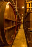 ITALY WINEMAKING BARRELS CELLAR. Wine barrels in cellar in Italy, Tuscan royalty free stock photography