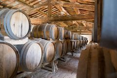 ITALY WINEMAKING BARRELS CELLAR. Wine barrels in cellar in Italy, Tuscan stock images