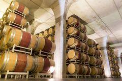 ITALY WINEMAKING BARRELS CELLAR. Wine barrels in cellar in Italy, Tuscan royalty free stock photo