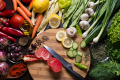 Кitchen knife and sliced vegetables on a cutting board. Photo from directly above of a kitchen knife and sliced vegetables on a cutting board and variation of Royalty Free Stock Photo