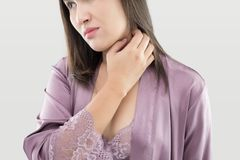 Itching neck. Asianl woman itching and scratching by hand, itching Neck, Healthcare And Medicine - People with skin problem concept stock images