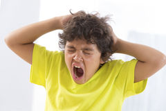 Itchy Scalp from Head Lice - angry face. Itchy Scalp from Head Lice very angry little boy Royalty Free Stock Photo