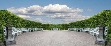 Item Park with smoothly trimmed bushes. And benches set in a semicircle Royalty Free Stock Images