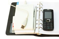Items for the businessman. Black notebook, pen, mobile phone and External Hard Drive good gift for the businessman. White background Stock Photos
