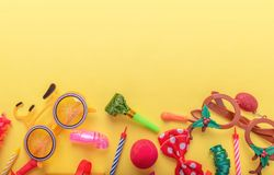 Items for carnival on yellow background. stock photography
