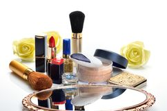 Items for decorative cosmetics, makeup, mirror and flowers Stock Photos