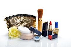Items for decorative cosmetics, makeup, mirror and flowers Royalty Free Stock Photos