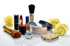 Items for decorative cosmetics, makeup, mirror and flowers Stock Image