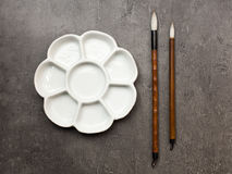 Items for drawing sumi-e, Chinese brushes, ceramic palette. stock photography