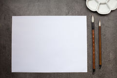 Items for drawing sumi-e, rice paper, Chinese brushes, ceramic p royalty free stock photos