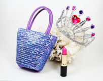Items of Fashion. Sequined handbag, tiara and lipstick with white coral Royalty Free Stock Photos
