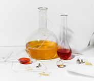 Items from laboratory chemists. Items from research lab, surrounded by flasks whit colored liquids, on Stock Photos
