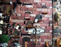 Items mounted on the wall at Exeter stock images
