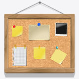 Items pinned to a cork message board Stock Image