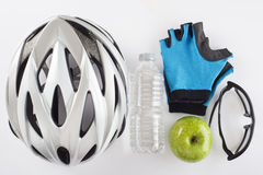 Items for a safe cycling and a healthy diet Royalty Free Stock Images