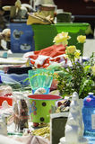 Items For Sale. A Table Displaying Miscellaneous Items For Sale at a Flea Market on a warm Spring Morning stock photography