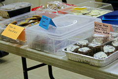 Items set up on a table at a bake sale.  Stock Image