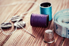 Items for sewing or DIY. Bright image of sewing kit accessories on wooden table royalty free stock photography