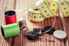 Items for sewing or DIY. Bright image of sewing kit accessories on wooden table royalty free stock image