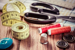 Items for sewing or DIY. Bright image of sewing kit accessories on wooden table stock photography