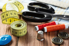 Items for sewing or DIY. Bright image of sewing kit accessories on wooden table stock image