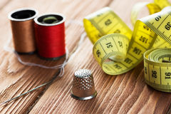 Items for sewing or DIY. Bright image of sewing kit accessories on wooden table stock photo