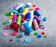 Items for sewing. On a gray stone background royalty free stock photo
