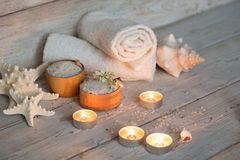 Items for spa. Towels and candles Stock Photos