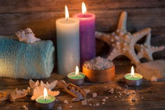 Items for spa. Towels and candles Stock Photography