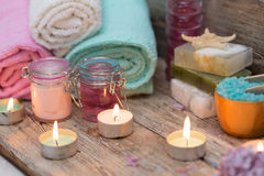 Items for spa. Towels and candles Stock Images